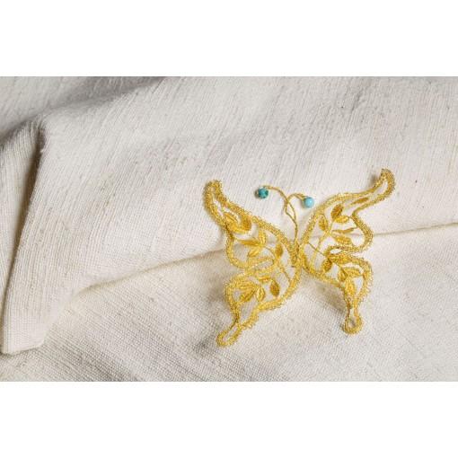 Farfalla in merletto con turchesi piccoli