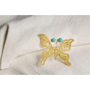 Farfalla in merletto con turchesi grandi