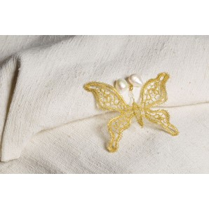 Farfalla in merletto con perle barocche